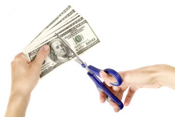 cutting money with scissors