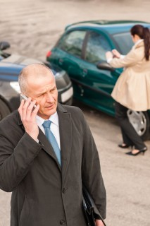 man calling attorney after a car accident