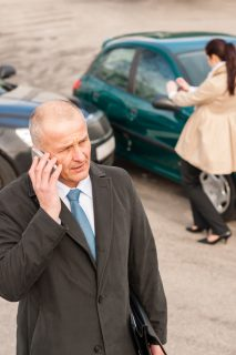 man on the phone after car accident