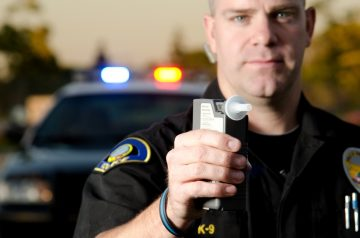 police officer with breathalizer