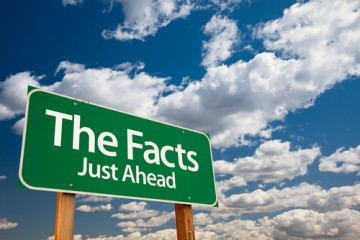 the facts just ahead road sign