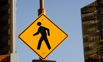 busy city intersection crosswalk sign