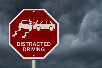 stop distracted driving road sign