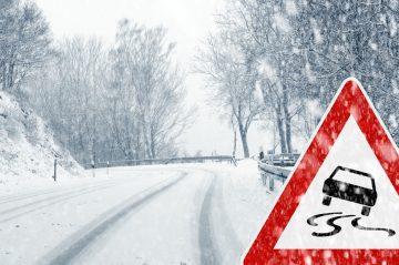 snowy road curve caution