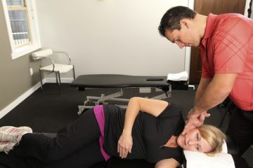 woman being adjusted at the chiropractor