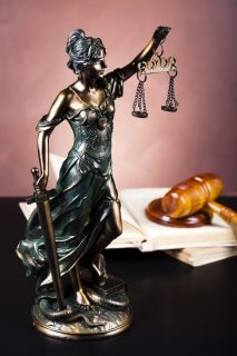 statue of lady justice on desk