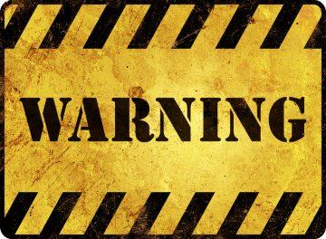 a big yellow warning sign