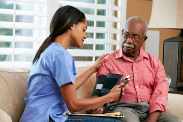home nurse taking blood pressure