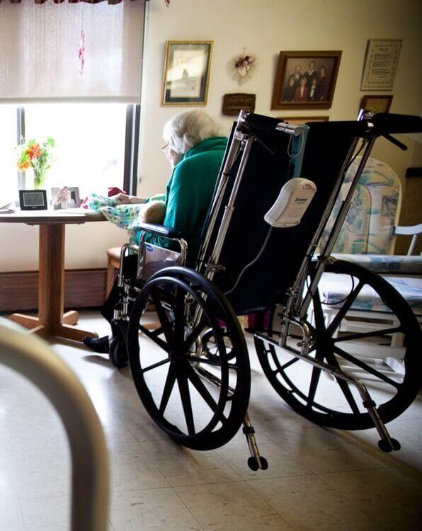 elderly lady in nursing home crocheting a blanket