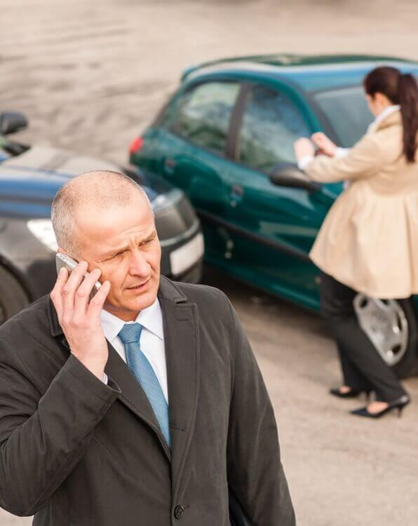 man calling his attorney after a car accident